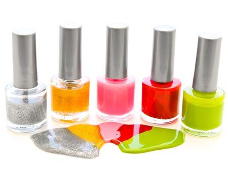 to lacquer: photo of the multicolored liquid lacquer over white background Stock Photo