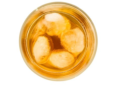 glass of alcoholoic drink with ice cubes photo