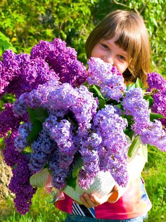 teeny: photo of the spring girl with lilac bouquet Stock Photo