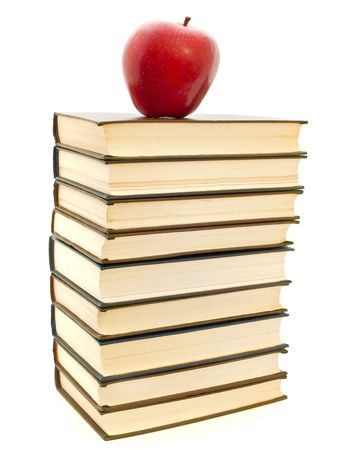 red apple at the top of books stack photo