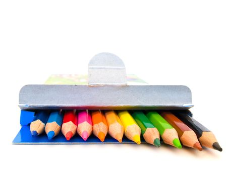 row of coloured pencils over the white background photo