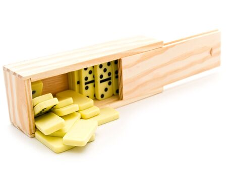 domino in wooden box against the white background photo