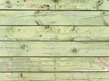 weathered: painted in green old wooden background