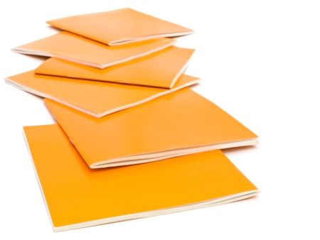 guidebook: photo of the some orange brochures against the white background