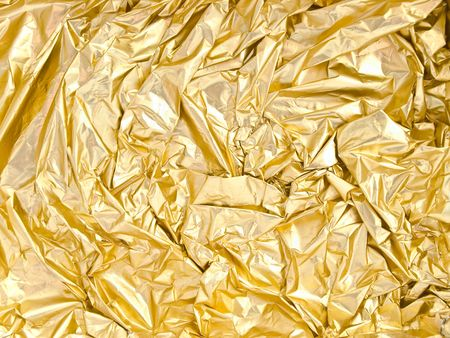 photo of the golden background from crumpled foil photo
