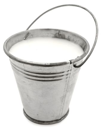 metal bucket with milk against the white background  photo