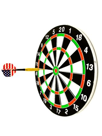 darts flying: darts arrow flying in the center of dartboard against the white background Stock Photo