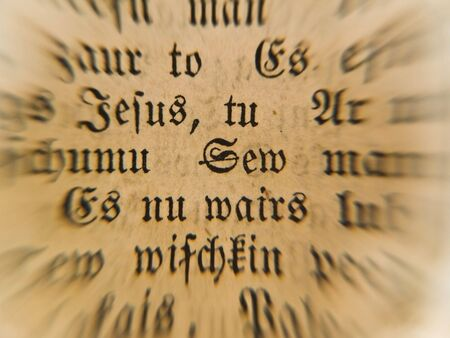 old bible text under the magnifying glass photo