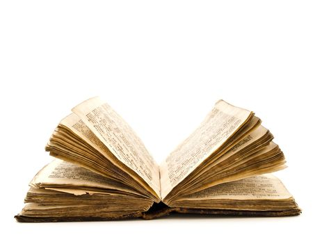 pile of books: vecchio apre il libro contro lo sfondo bianco  Archivio Fotografico