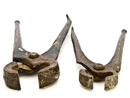 pinchers: photo of the old rusty pliers against the white background