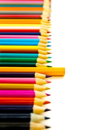 Straight row of the multicolored pencils with one another against the white background Stock Photo - 5605611