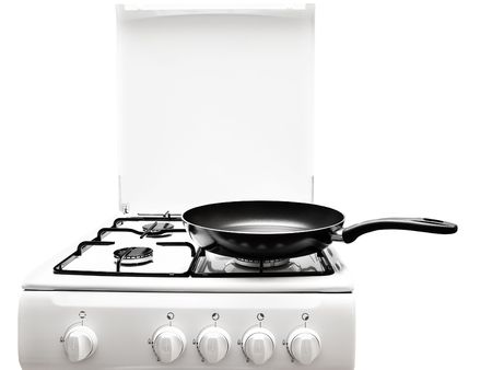 frying pan at the white gas stove over the white background photo