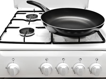 frying pan on the white gas cooker photo