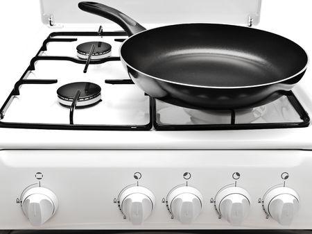 gas cooker: la sart�n en la cocina de gas blanco Foto de archivo