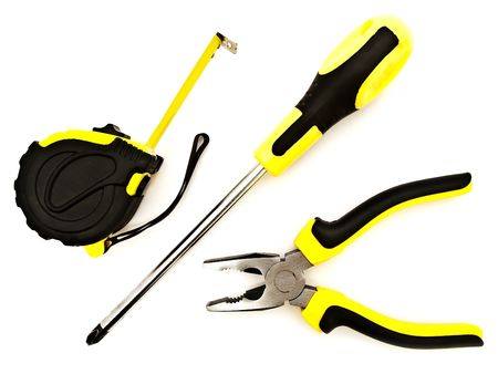 Photo of pliers, screwdriver and meter against the white background photo