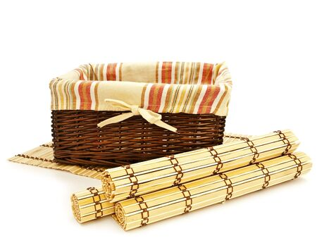 wattled: empty basket for food with wattled bamboo mats against the white background  Stock Photo