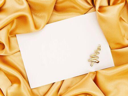 lustre: Golden silk textile border round white paper with golden firtree decoration