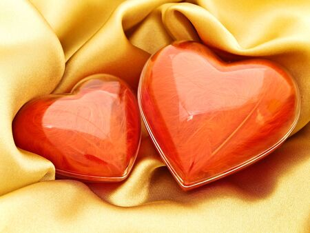 red hearts at golden fabric drapery background 스톡 사진