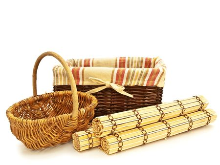 woven: empty picnic baskets for food with wattled bamboo mats against the white background