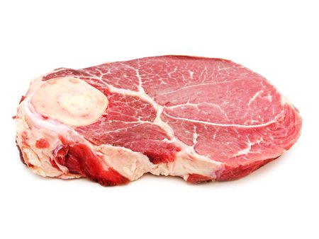 raw ham: Big piece of raw meat against the white background
