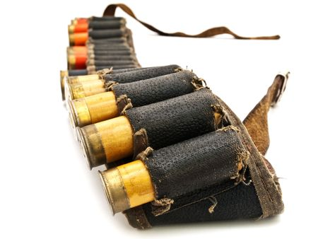 cartridge belt: Photo of old cartridge in leather belt for hunting rifle against white background