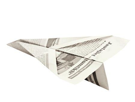 papierflugzeug: Zeitung Flugzeug vor wei�em Hintergrund  Lizenzfreie Bilder