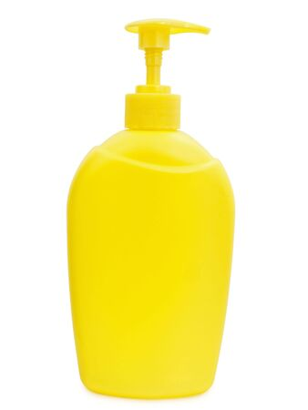 hygienics: yellow plastic bottle of liquid soap over white