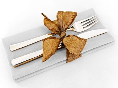 serviette: decorated table serving with golden bow in serviette at clear grey Stock Photo