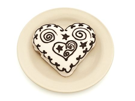spicecake: Photo of spice cake in heart shape in plate against white background