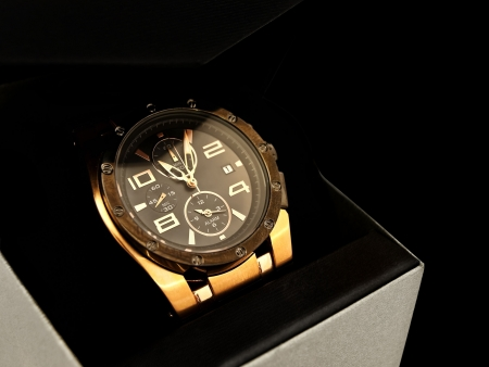 timekeeper: luxury man watch in gift box against black background Stock Photo