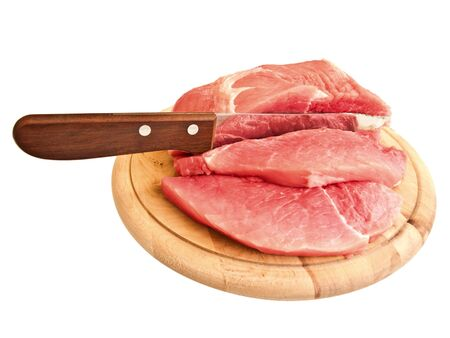 piecies: piecies of meat with knife on the hardboard over white