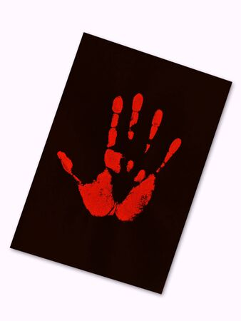 red hand print on the black paper photo