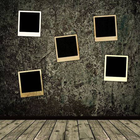 old photo frames over the grunge wall background Stock Photo - 6872646