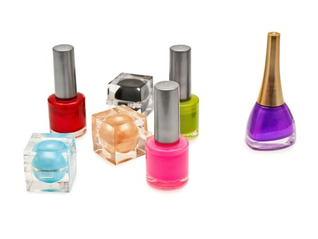 multicolored cosmetic tools: nail polish and shadow over white background Stock Photo - 6973392