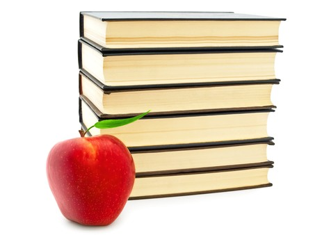 Back to school!  theme with red apple and stack of books over white photo