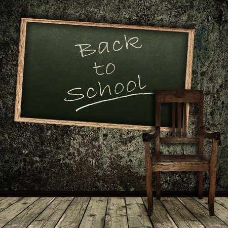 school aged: Photo of abstract grunge shabby interior with school blackboard and single chair Stock Photo