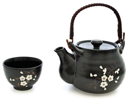 china tableware for chinese tea ceremony: teapot and bowl over white background photo