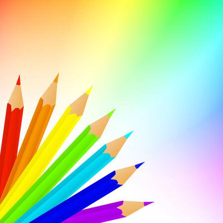 lápices brillantes sobre el arco iris con copyspace para el texto