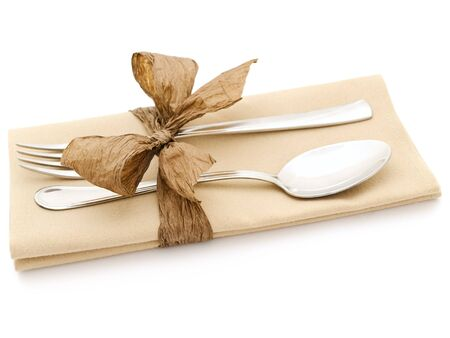 serviette: fork and spoon at serviette with bow over white Stock Photo