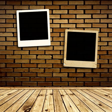 two photo frames at brick wall Stock Photo - 7350304