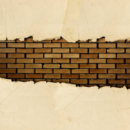 vintage torn paper with copyspace for your text at brick wall Stock Photo - 7580924
