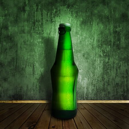 cool beer bottle at wooden floor over grunge wall Stock Photo - 7580938