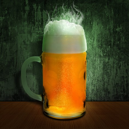 cool beer mug at wooden table over grunge wall  Stock Photo - 7580937