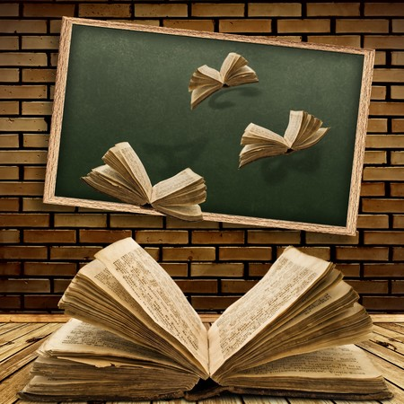 Photo of urban interior with school blackboard and opened vintage flying book  Archivio Fotografico