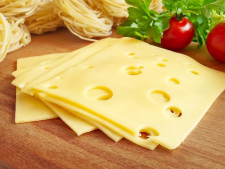 hardboard: cheese, pasta and vegetables on the hardboard