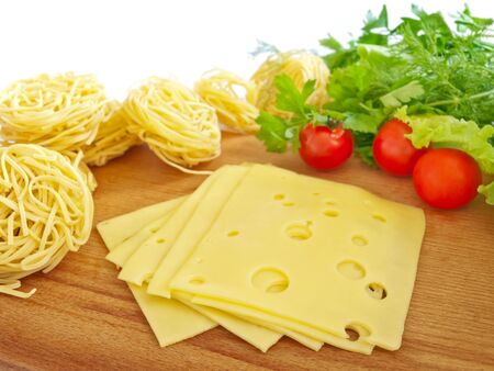 hardboard: cheese, pasta and vegetables on the hardboard Stock Photo
