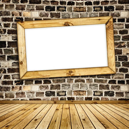 Empty wooden frame at brick wall in interior with wooden floor Stock Photo - 8145649