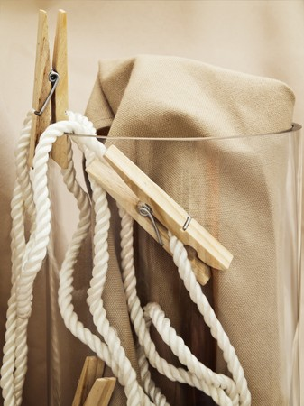 handmade composition with vintage pins and rope over beige photo