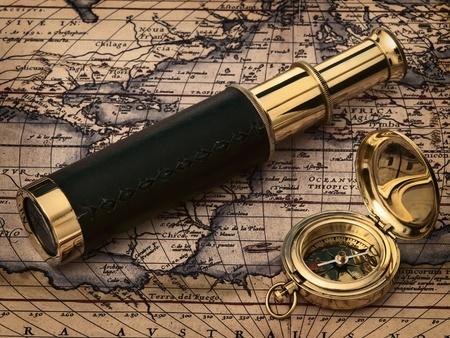 bygone: travelling theme: vintage clock at antique map