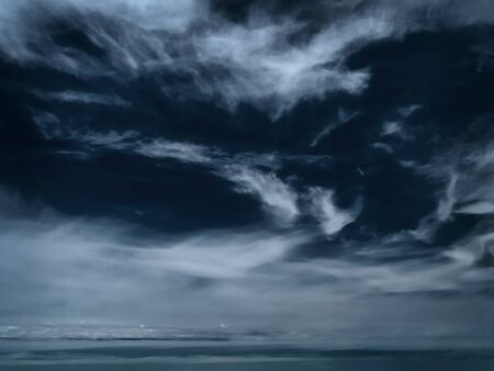 overcast stormy sky over the sea in winter photo